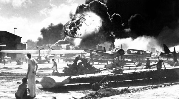 Captured Japanese photograph taken during the attack on Pearl Harbor, December 7, 1941. In the distance, the smoke rises from Hickam Field. (Navy)NARA FILE #: 080-G-19948WAR & CONFLICT BOOK #: 1134